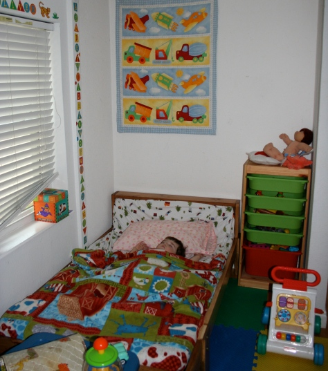 A cheery big boy room... complete with sleeping boy.
