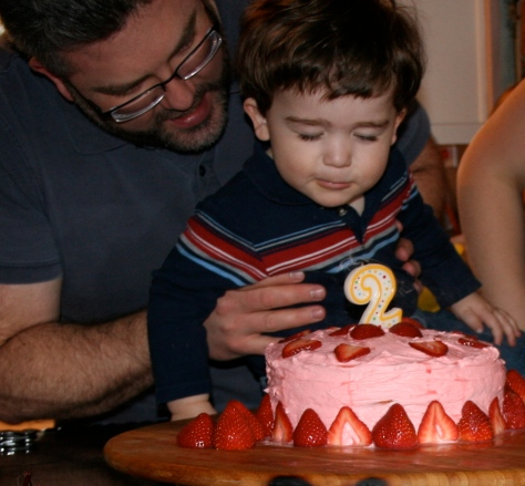Closing his eyes, he makes a wish and blows out the candle.