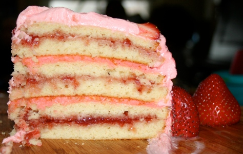 Six layers of frosting and Strawberry jam between Vanilla cake.